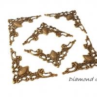 Ozdobný kovový roh 52 x 27 mm - bronzový